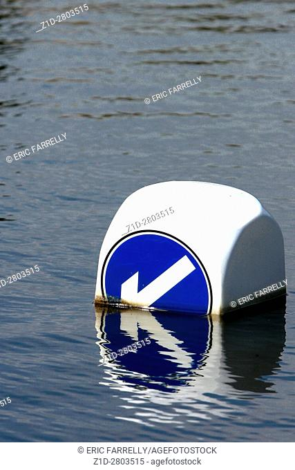 flooding obscuring road bollard