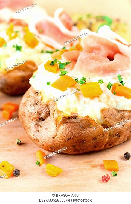 Stuffed potatoes with white cheese cream and prosciutto