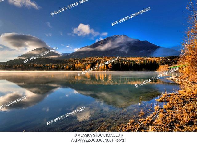 Fall colors and the Kenai Mountains reflecting on a misty Kenai Lake at Cooper Landing, Kenai Peninsula, Southcentral Alaska, Autumn, HDR