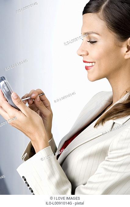 A businesswoman using a PDA