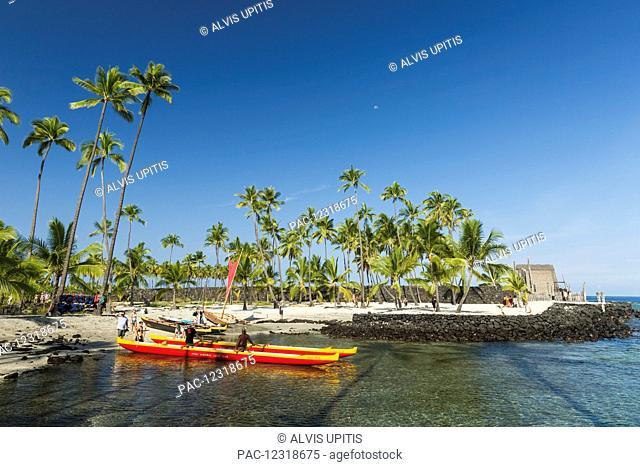 Hawaiian outrigger and sailing canoes in Pu'uhonua O Honaunau National Park; Honaunau, Island of Hawaii, Hawaii, United States of America