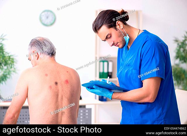 Old man visiting male doctor dermatologist