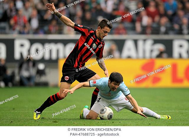 Frankfurt's Joselu (TOP) and Mainz' Joo-Ho Park (BOTTOM) vie for the ball during the Bundesliga soccer match between Eintracht Frankfurt and 1