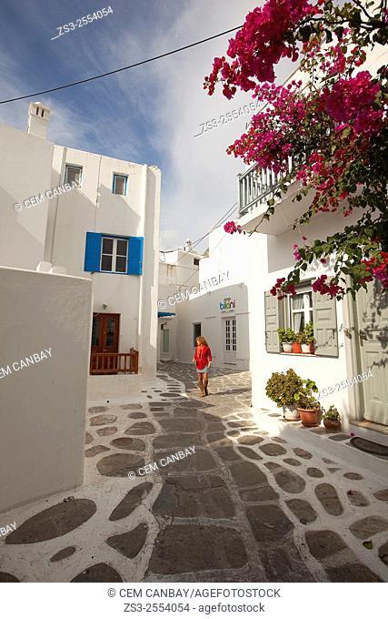 Woman walking in the alleys of town center, Mykonos, Cyclades Islands, Greek Islands, Greece, Europe