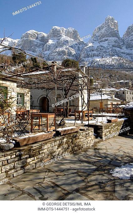 Snowy Mikro Papingo village and mountains. Mikro Papingo, Ioannina, Epiros, Greece, Europe