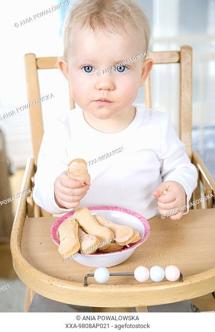 baby girl eating cookies