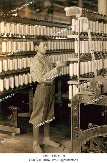 Young Teen Boy Working in Mule Room at Berkshire Cotton Mill, Adams, Massachusetts, USA, circa 1916