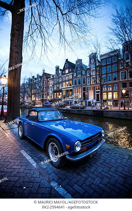 Nice blue sport car parked at Leidsegracht canal, Amsterdam, The Netherlands