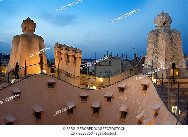 Casa Mila, La Pedrera, skyline of Barcelona, Spain. The chimneys. Panorama of the roof at dusk, evening, night. Unesco Heritage