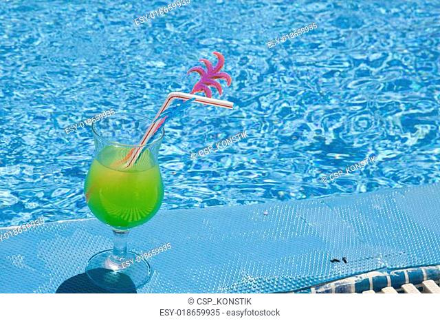 cocktail on edge of pool
