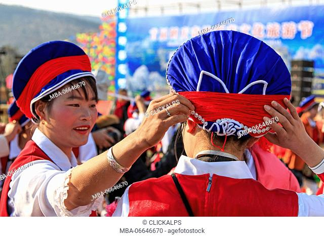 Chinese women in ancient Bai clothing during the Heqing Qifeng Pear Flower festival, China