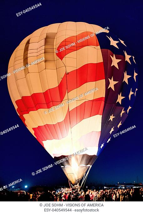 OCTOBER 7, 2017 - Albuquerque, New Mexico - Colorful Hot Air Balloons at Morning Glow Event at the Albuquerque Balloon Fiesta shows US Flag