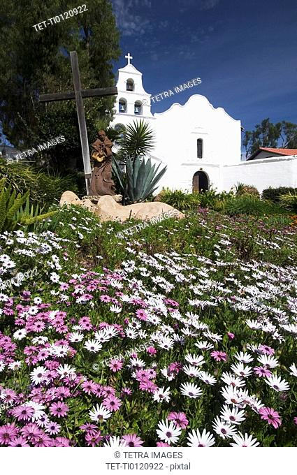 Meadow with church in background, Mission San Diego de Alcala, San Diego, California, United States