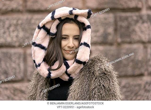 vital woman head enveloped in scarf, playful positive, cold temperatures, happiness, content, in Munich, Germany