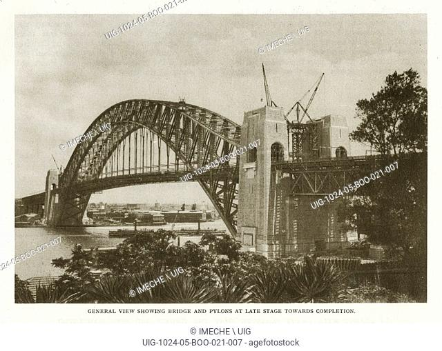 Sydney Harbour Bridge: general view showing bridge and pylons at late stage towards completion