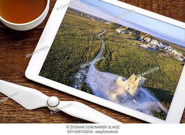 Castle Rock - limestone pillar landmark in prairie of western Kansas, reviewing aerial image on a digital tablet