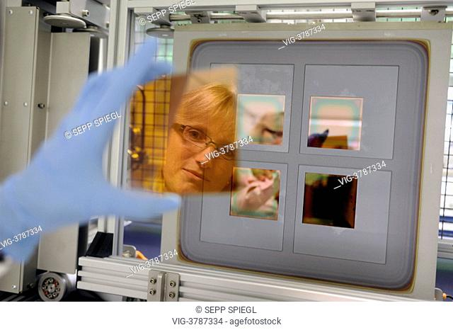 Germany, Gelsenkirchen, The Laboratory and Service Center (LSC) of the Fraunhofer Institute for Solar Energy Systems. A thin film solar cell is coated with...