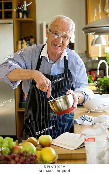 Senior man cooking, Sweden
