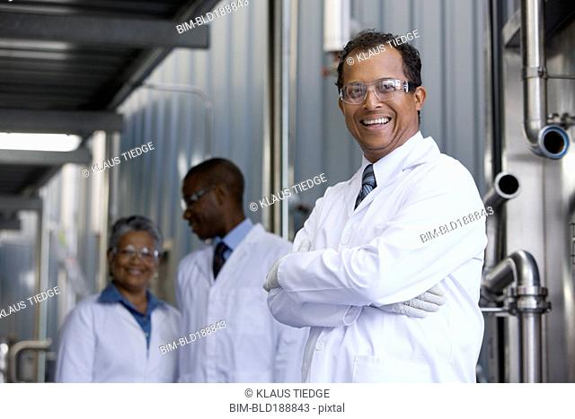 African scientists standing in factory