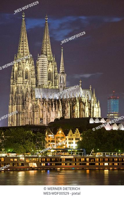 Germany, Cologne, Cathedral illuminated at night