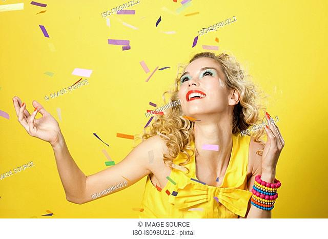 Young blonde woman with colourful confetti