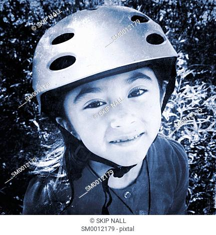 Portrait of a little girl wearing a bicycle helmet