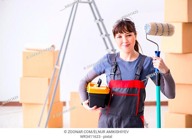 Woman painter painting in new apartment