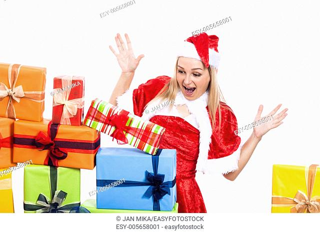 Surprised Christmas woman looking at many presents, isolated on white background