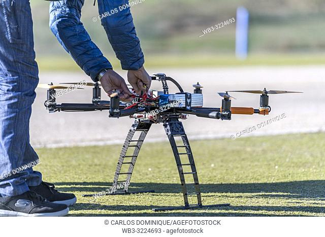 Professional drone being connected with lithium batteries