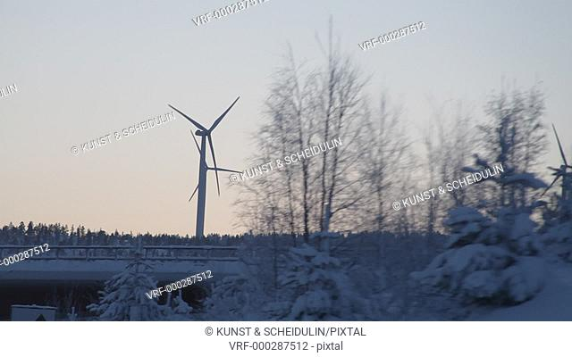 Wind turbines shot from a driving car on a cold winter day. Utansjö, Västernorrlands Län, Sweden