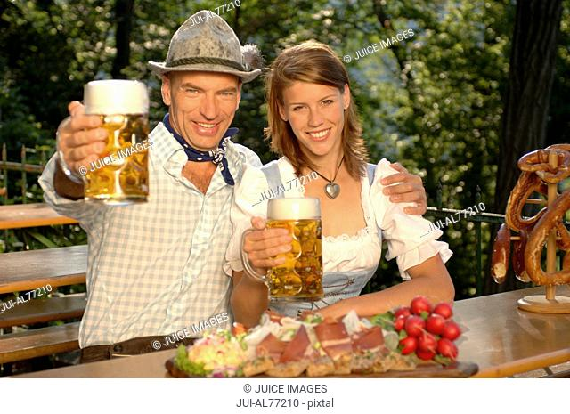 View of a young couple drinking beer, beergarden, Munich, Bavaria, Germany
