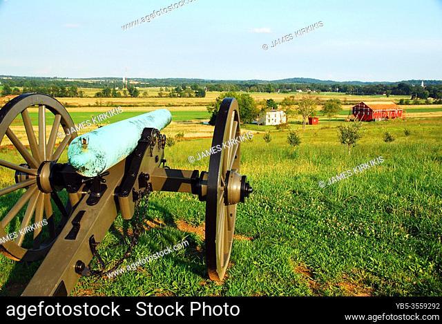 A Civil War era cannon looks over farmland from Gettysburg National Battlefield