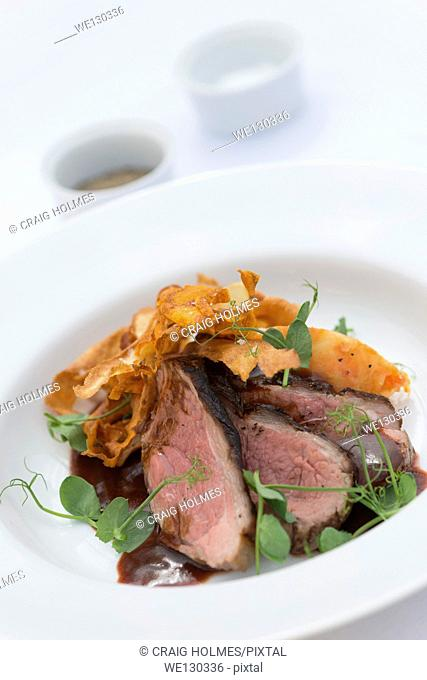 Beef and parsnip crisps, served with lambs lettuce