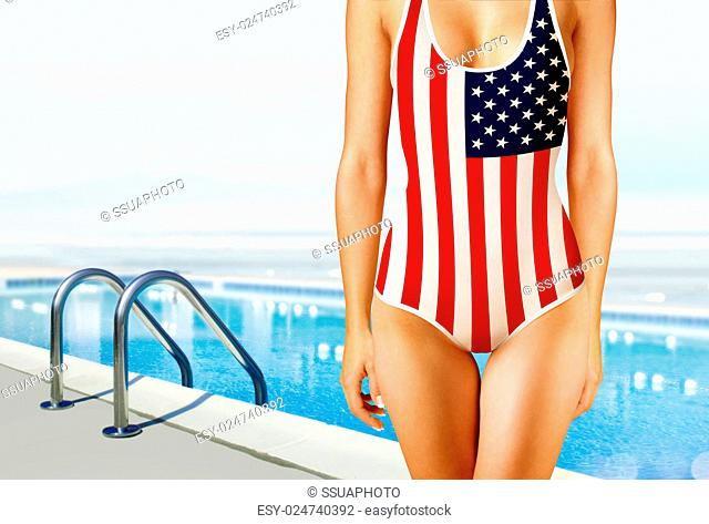 part of woman in swimwear as the American flag near swimming pool