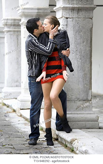 Young couple kissing on romantic street