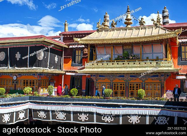 Close up of the rooftop of Jokhang Temple. In the middle the famous dharma wheel and deers. At the bottom part small buddha statues. Buddhist art
