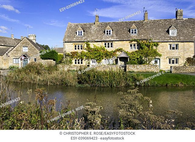 England, Gloucestershire, Cotswolds, idyllic old stone cottages at Lower Slaughter in autumn sunshine