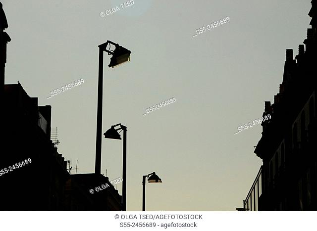 Streetlamps in the sunset, backlit. Portal D'Angel, Barcelona, Catalonia, Spain