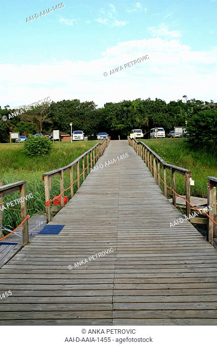 Wooden bridge leading to dock at St Lucia Estuary, St Lucia, KwaZulu Natal, South Africa. 17/03/2011