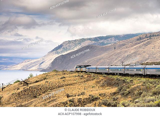 Passenger train travelling along Kamlopps Lake in British Columbia, Canada