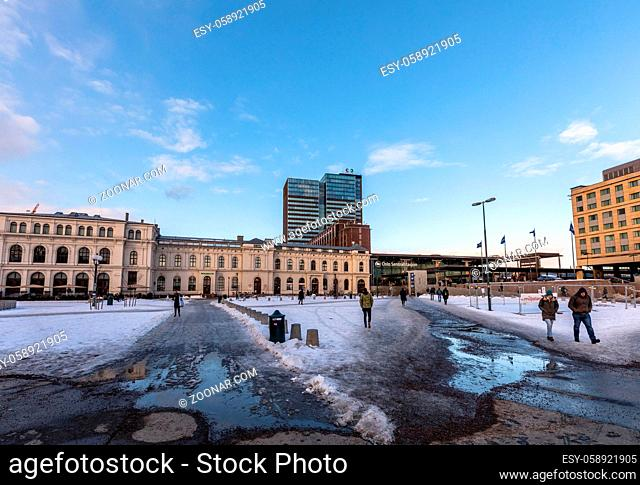 Oslo Central Station, day, people walking, snow on the ground