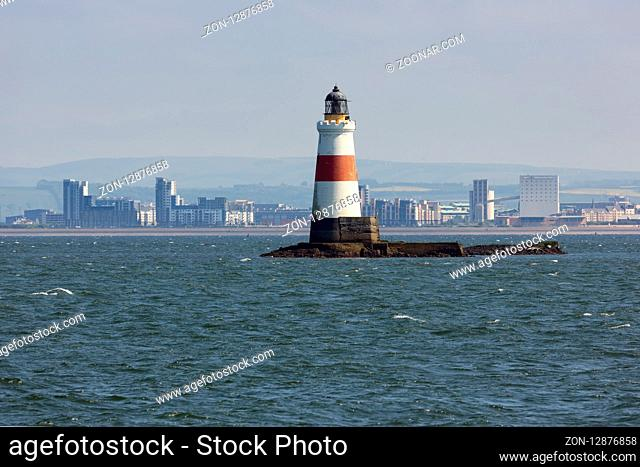 Lighthouse at small island in Firth of Forth near coast of Scottisch Edinburgh