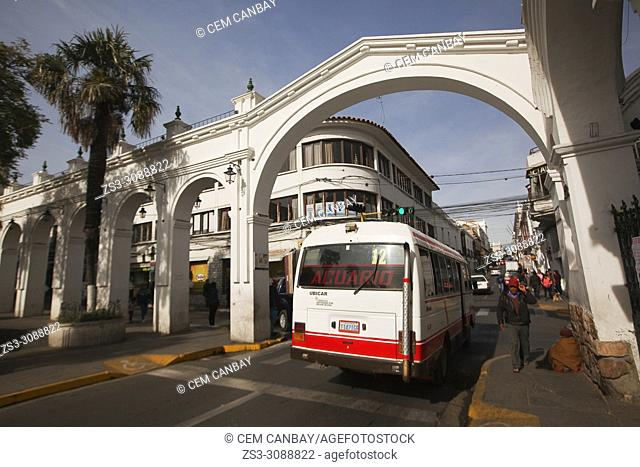 Local bus passing through the Aniceto Arce- Aniceto Arch in the historic center, Sucre, Chuquisaca Department, Bolivia, South America