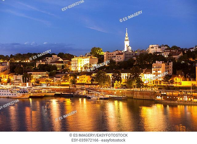 Night view of Belgrade's Sava River waterfront area with St Michael's Cathedral