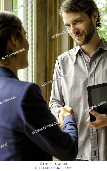 Sales person meeting with prospective client