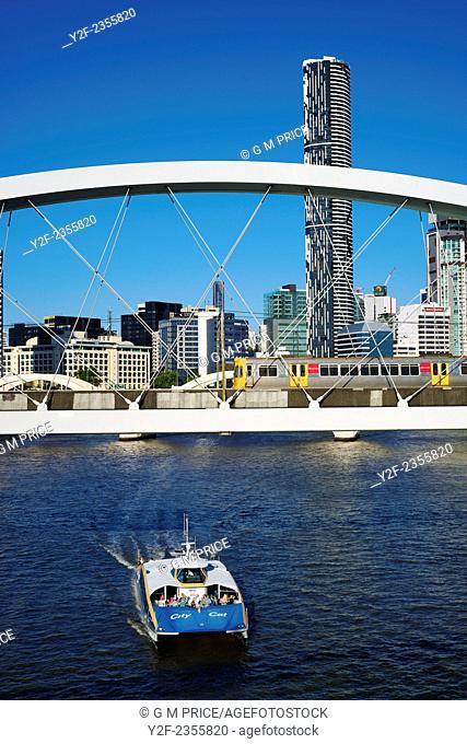Brisbane River ferry beneath rail bridge and train, with city skyline, Australia, composite image