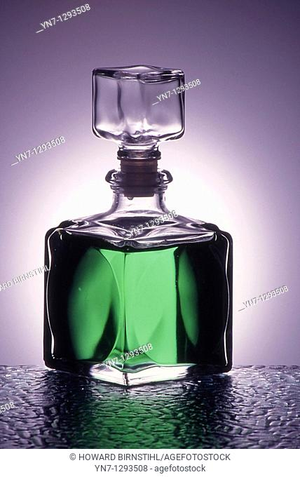 generic bottle of glowing green liquid backlit