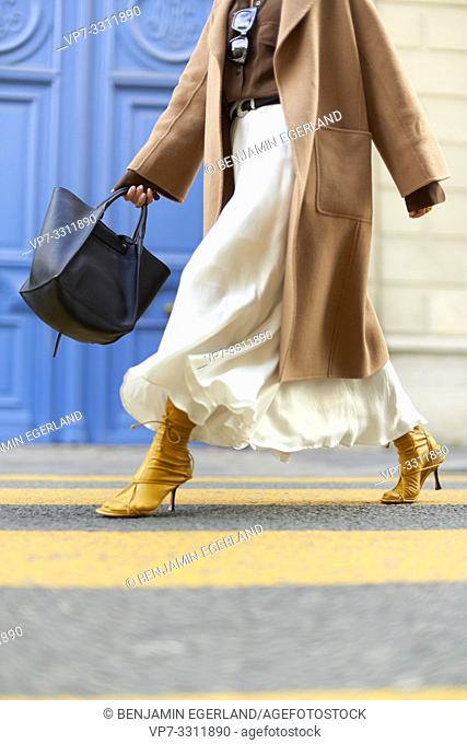 shoes of fashionable blogger woman, yellow high heels, at street during fashion week, streetstyle, in city Paris, France