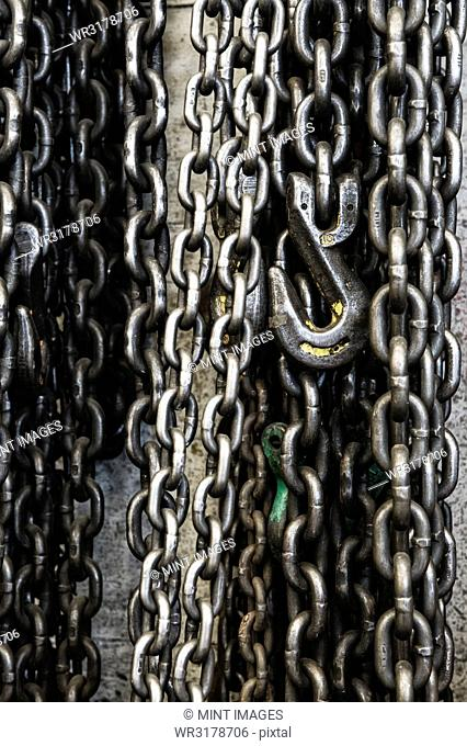 Closeup still life of chains and lift hook used in a sheet metal factory