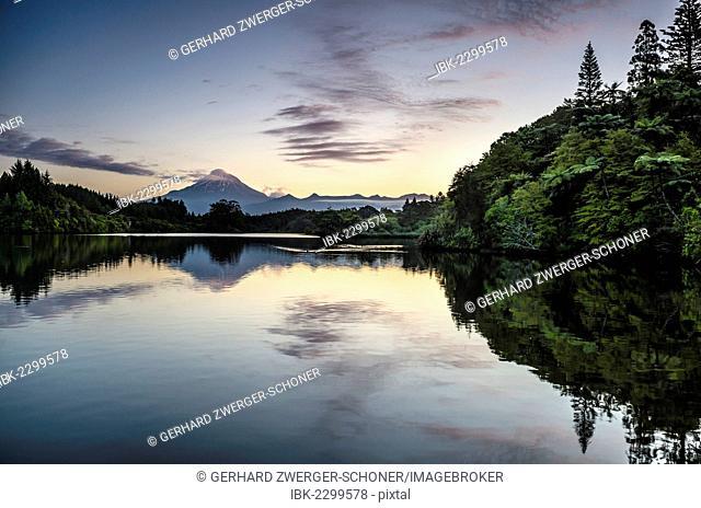 Currently inactive volcano, Mt. Egmont, Mt. Taranaki, reflection in the reservoir of Lake Mangamahoe, North Island, New Zealand